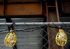romeo & juliet (nardell) Tags: light philadelphia rust sting lightbulbs fences shakespeare streetscene cage pa soul constructionsite protection fragile beams cages photostory romeojuliet buildiing dangerousideas butitsfriday thisoneisastretch