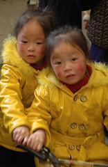 D7 - Double yellow (Purple Cloud) Tags: china november food yellow kids twins market 2006 shangrila local yunnan zhongdian