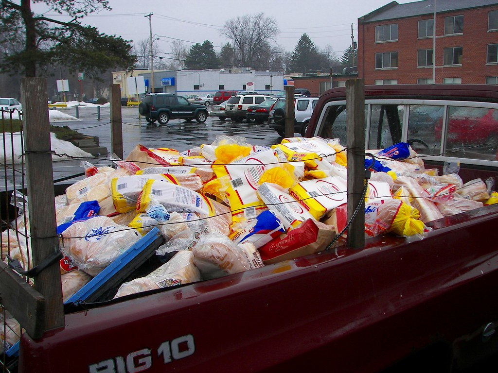Red pickup truck full of leftover bread