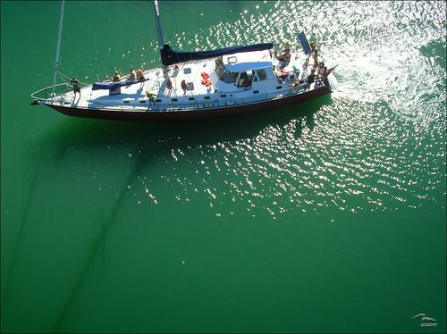 Yacht on bottle green marina