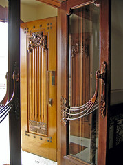 Art Deco Doors (f0rbe5) Tags: wood newzealand brown building glass 350d design wooden carved doors decoration 2006 carving northisland artdeco deco napier aotearoa rothmans nationaltobaccocompany ahuriri nationaltobaccocompanybuilding artdecodoors rothmansbuilding
