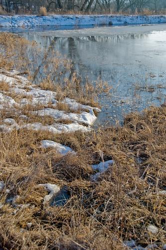Little creek running into the full pond