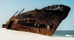 Wrecked in Mozambique (Zulpha) Tags: ocean africa old beach metal canon sand rust war scan top20rust wreck portuguese mozambique interestingness467 i500 explore16feb06