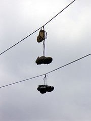 Shoes Suspended (little-wings) Tags: blue summer sky 2004 washingtondc dc shoes july georgetown powerlines  leftbehind   nwdc