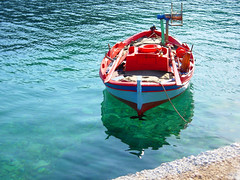 Red Boat (mnadi) Tags: blue sea sun macro green water colors closeup reflections boats island boat fishing sailing outdoor turquoise azure greece lonely nautical closeups kefallonia أزرق بحر أحمر