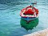 Red Boat (mnadi) Tags: blue sea sun macro green water colors closeup reflections boats island boat fishing sailing outdoor turquoise azure greece lonely nautical closeups kefallonia أزرق بحر أحمر