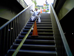 Painter on Chicago's Wacker Drive stairs