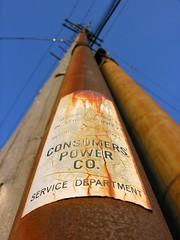 Rusty (O Caritas) Tags: powerpole conduit lookingup powerlines telephonepole warning fading