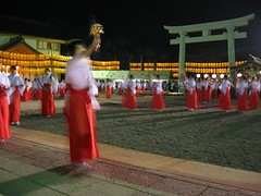 second round with bells (vfowler) Tags: 2005 15fav woman festival japan night temple asia hiroshima   shinto torii         shint