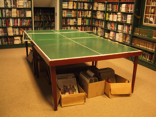 Image of a Ping Pong table in the middle of a library