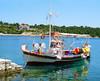 Boat Reflections (mnadi) Tags: blue sea summer reflection water sunshine reflections boats island greek islands boat fishing outdoor sunny greece nautical kefalonia ionic assos أزرق بحر