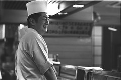 Sushi Chef (Jim O'Connell) Tags: pictures people blackandwhite bw film japan darkroom sushi tokyo nikon mine availablelight chef nikomat mmdc