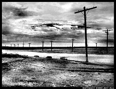 Poles (Jeff T. Alu) Tags: desert digital california surreal moody lonely dark outdoors bleak blackandwhite deserted illusion zen medetation medetate power impact graphic doom bright earthy dirt gritty intense visionary heat passion 4x4 remote desolate dreamy nightmare euphoric