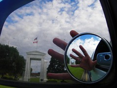 Rearview Mirror at the border with Hand