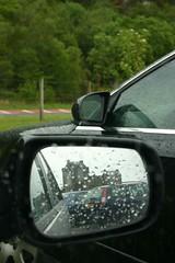 Eilean Donan, Car Park (itmpa) Tags: reflection slr castle tourism wet rain canon scotland 300d canon300d renovation tartan wingmirror eileandonancastle shortbreadtin tomparnell itmpa archhist