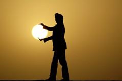 holding sun