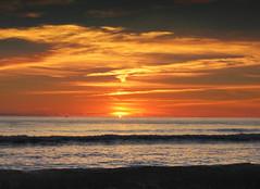 Sizzle (peke_cheeks) Tags: sunset sea sky portugal algarve sunsetsunrise colorphotoaward