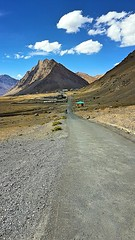 Straight Empty Roads passing through the natural beauty... (rubal033) Tags: himalayas himachalpradesh spiti canon70d canon 18135 nature mountains hills landscape bike riders path road dessert river clouds indian