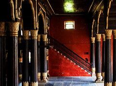 Stairs and pillars, Sultan Tipu Palace, Bangalore, India, March 2011 (Juha Riissanen) Tags: india bangalore bengaluru tipu sultan palace stairs pillars window reflection red gold black ancient