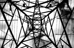 Hi Voltage (Dave G Kelly) Tags: ireland blackandwhite dublin white black tower electric digital canon eos 350d interestingness august 2006 pylon electricity barbwire canoneos350d hydrotower irlandia 1855lens interestingness31 interestingness142 i500 aplusphoto davegkelly