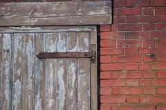 A bit of a door (danpea) Tags: door hinge uk england wall neglect bricks derelict stalbans december2006 danpea danielpeacock