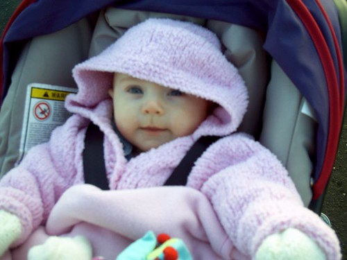 Rosemary in her new cardie in her buggy