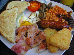 heathrow breakfast (bobby stokes) Tags: uk england stilllife london tomato mushrooms bacon tate heathrow toast sausage meat friedegg bakedbeans hashbrowns fryup fullenglishbreakfast hpsauce  fullenglish londonist howwearenow