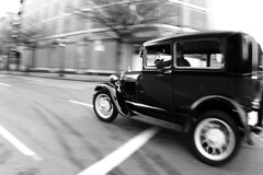 the getaway ( marc_l'esperance) Tags: auto blackandwhite bw blur monochrome car vancouver canon vintage eos blurry automobile shiny paint downtown raw antique spoke wheels  fisheye american 10d restored nocrop eastside panning uncropped coupe allrightsreserved 2007 greyscale cml gvrd canonef15mmf28fisheye abigfave minimalpostproduction aplusphoto