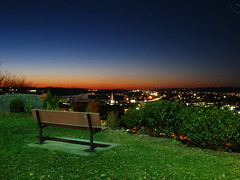 Quincy Park over Parkersburg, WV (Skylight Photography) Tags: park city longexposure sunset skyline night digital canon dark bench quincy colorful nightshot availablelight vivid powershot westvirginia citylights parkbench parkersburg notphotoshopped canonpowershot a620 takenbyandy 250v10f sunsetovercity