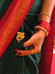 scenes out of a wedding (shubhangi athalye) Tags: wedding red india green gold bombay maharashtra henna mumbai ethnic sari bangles redandgreen greenandred maharashtrian indianculture colorfulsaree traditionalgarb sa
