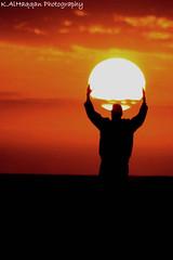 Wait .. Don't go !! (Khalid AlHaqqan) Tags: sunset sun man guy canon lens hands zoom usm khalid ef grap 90300mm f4056 abigfave kuwson alhaqqan