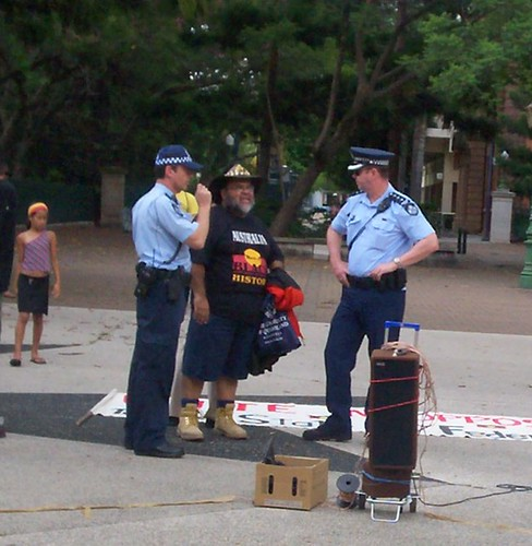 Sam Watson discusses arrangements with police - Invasion Day Rally and March, Parliament House, George St, Brisbane, Queensland, Australia 070126-1