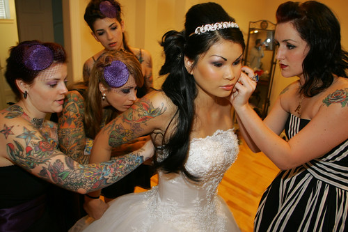 matching couple tattoos. tattooed bride