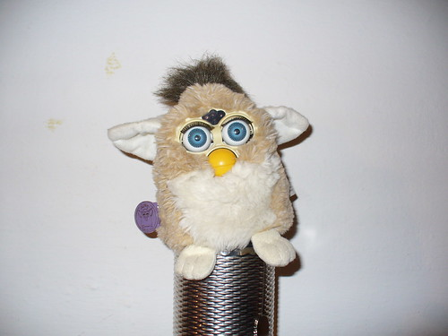 Troubled Furby standing on top of a metal guiro