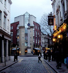 Seven Dials cobblestone Street (londonconstant) Tags: uk england london architecture modern night square lights pub nightshot victorian londonbynight noflash cobblestones gb coventgarden column notripod thecrown sevendials londonatnight londonpub citytrees postwwii