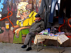 street vendor (jovivebo) Tags: streetart man male topf25 painting graffiti mural europe romania vendor bucharest wallpainting streetvendor top20travelportraits