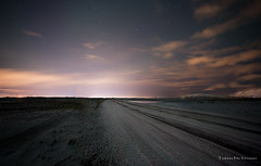 On the road...again (.:: Tomz ::.) Tags: longexposure winter light sky mountain snow mountains color ice nature topf25 beautiful lines rock night canon wow dark stars star frozen iceland rocks alone 2006 reykjavik line nighttime 5d canon5d reykjavk sland icelandic stjarna canon1740mmf4l tomz slenskur 25faves p1f1 tomaszrveruson aplusphoto stjrnur