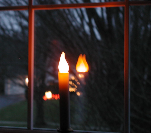window candle at dawn