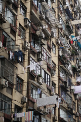 Flags Raised (memetic) Tags: china windows canon 350d apartment shanghai flags clothes hanging poles clothesline airconditioners 50mmf14 chinatripdec2006