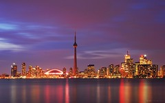 Windy Evening On Toronto Skyline (David Giral | davidgiralphoto.com) Tags: longexposure pink blue sky urban chien toronto ontario canada david reflection tower skyline night skyscraper cn landscape evening nikon long exposure cityscape cntower skyscrapers purple shot dusk windy hour royalyork highrise entre loup bluehour d200 et fairmont heure giral rogerscenter magique nikond200 vle 18200mmf3556gvr entrechienetloup copyrightdgiral davidgiral bestofr