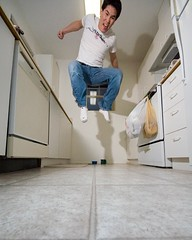 taking flight (poopoorama) Tags: selfportrait me kitchen digital jump nikon d70 sigma danny 1020mm sigma1020mm 365daysouttake 365reject utatajumps day35outtake flickr:user=poopoorama