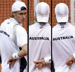 hewitt, playing doubles, in white