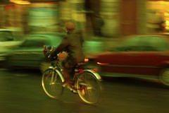 allez (p2wy) Tags: woman blur paris france topf25 bike bicycle d50 geotagged 50mm interestingness interesting dusk streetphotography explore nikkor f18 50mmf18d panning yellowfilter framehouse p2wy 50mmf18af i100 6earrondissement nikonstunninggallery