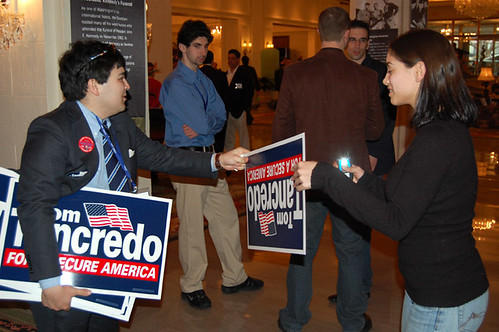 Marcus Epstein hands out Tom Tancredo signs at the 2007 Conservative Political Action Conference. Photo by: Dave Weigel.