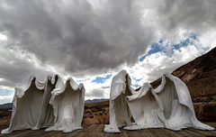 (shadowplay) Tags: sculpture storm desert nevada ghosttown 12mm rhyolite oddness lastsupper albertszukalski