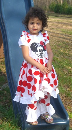 kaya in her minnie dress