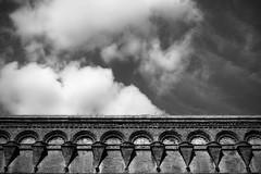 Siena (-Aldievel-) Tags: toscana italy leica blackandwhite cloud sky italia clouds tuscany monochrome siena mura cielo brick biancoenero bricks nuvole nuvola mattoni portapispini