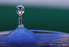 Droplets with reflection Image II (dawey [Mohammad Alhameed]) Tags: blue macro reflection water droplets canon20d drop droplet tap  dripping 100macro canon100macro vwc   kuwaitvoluntaryworkcenter  photovwc kuwaitvwc