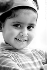 Angel Smile (Ammar Alothman) Tags: life portrait people blackandwhite bw baby cute eye love girl beautiful face look kids canon kid eyes flickr pretty gulf sweet gorgeous adorable 2006 kuwait 70200 kuwaitcity kw q8 30d canon70200  canon30d  thecontinuum kakadoo  kuwaitvoluntaryworkcenter