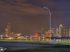 Lonely (DanielKHC) Tags: city longexposure shadow urban colors skyline night buildings wow singapore sony lamppost esplanade alpha hdr a100 hyperreal marinabay photomatix tonemapped sigma18200mm 5xp danielcheong hdrenfrancais danielkhc